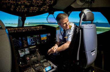 A pilot is preparing his next flight simulation on the Boeing 787. Cutting-edge full flight simulators (FFS) are part of the new multimillion dollar extension of the Etihad pilot training center.