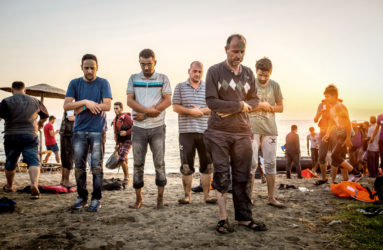 As soon as he stepped foot on land, Mohammed Nahji, 45, led the prayer to thank God for their safe arrival. He was a sports teacher in Deir Ezzor, Syria. Following the recent bombing, he left his wife and four children behind to find a way to support them financially.