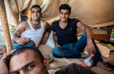 A group of Pakistani refugees at the abandoned Captain Elias Hotel.