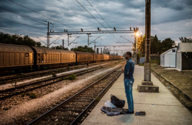 "Hussein, from Chichiga, Somalia, is praying in the early evening at a train station hundred meters aways from the Serbian border. He is still unsure about his final destination but he says to have ""a good feeling about Germany""."