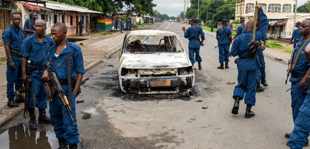 Police force on a crime scene in Mutakura. The rise of violence since the the protests began in April 2015, maintains the threat of a return to civil war in Burundi.