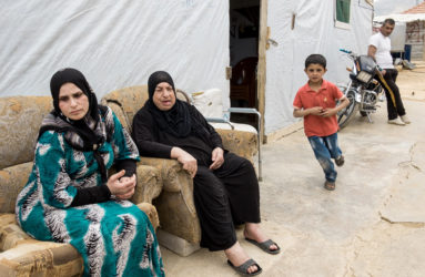 A family from Homs, who have been living in Beka'a Valley for the last three years. Three generations share the same tent.
