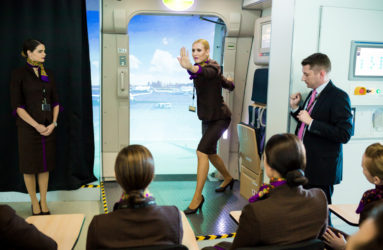 Flight attendants are going through a safety course at the training academy. Different scenarios are proposed to evaluate the students.