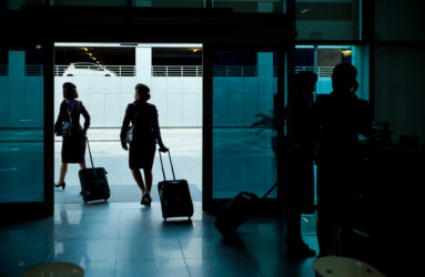 Cabin crew exiting the training center.